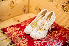Wedding Shoes Cream Color On The Chair Royalty Free Stock Photos