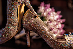 Wedding shoes with crystals wedding ring   Royalty Free Stock Photo