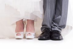 Wedding shoes details of a couple. Wedding shoes details on white background Stock Photos