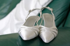 Wedding shoes and dress Stock Photos