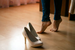 Wedding shoes on the floor. Bride's feet on the floor Royalty Free Stock Image