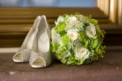 Wedding shoes and flowers bouquet Royalty Free Stock Image