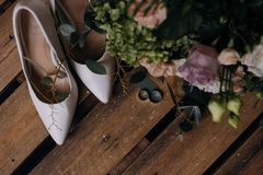 Wedding shoes and wedding gold rings royalty free stock photos
