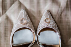 Wedding shoes. With golden rings Stock Images