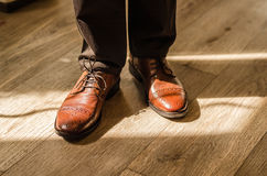 Wedding shoes groom. Bridal brown leather groom shoes Stock Photos
