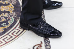 Wedding shoes groom standing on the marble floor Royalty Free Stock Photography