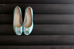 Wedding shoes hanging on wall Stock Photography