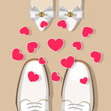 Wedding shoes and hearts. Pair of white wedding shoes for man and for woman, facing each other, and hearts over them Stock Image