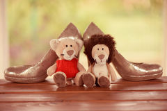Wedding shoes with lion and lioness toy Royalty Free Stock Images