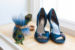 Wedding Shoes and Peacock Garter. A brides wedding shoes and peacock garter Stock Image