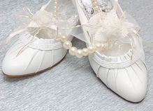 Wedding shoes with pearl necklace Stock Photo