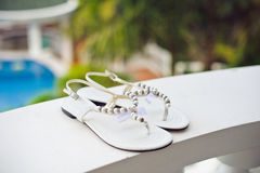 Wedding shoes on the pool background Stock Photos