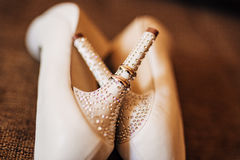 Wedding shoes on the pool background Stock Image