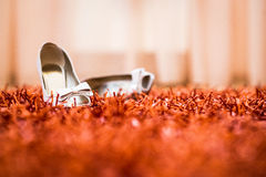 Wedding shoes on red carpet stock photos