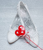 Wedding shoes with red heart Stock Photography