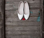 Wedding shoes and red heart on wood background Stock Photography