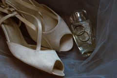 Wedding shoes, ring and perfume stock image
