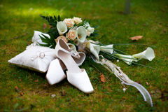 Wedding shoes rings and bouquet Stock Photography