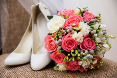 Wedding shoes rings and bouquet Stock Images