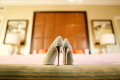 Wedding shoes. On the sofa stock images