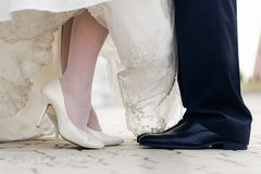 Wedding shoes in a standing bride and groom Royalty Free Stock Photography
