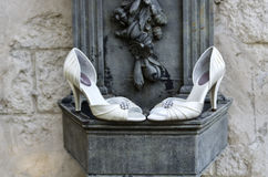 Wedding Shoes with Stone Wall & Sculpture Stock Image