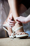 Wedding shoes. Switching wedding shoes in studio Stock Images