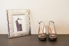Wedding shoes. On table with frame Stock Photos