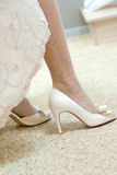 Wedding shoes on their feet Stock Images