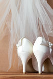 Wedding  shoes and veil Stock Photos