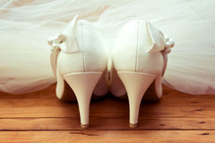 Wedding shoes and veil Stock Photo