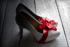 Wedding shoes on vintage white planks Royalty Free Stock Photos