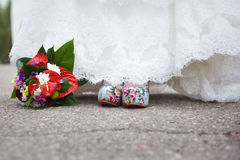 Wedding shoes and wedding bouquet Royalty Free Stock Image