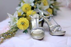 Wedding shoes and wedding bouquet of white yellow flower Stock Images