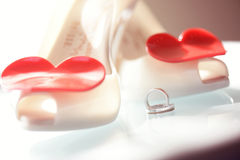 Wedding shoes and wedding rings Royalty Free Stock Images