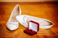 Wedding shoes and wedding rings royalty free stock photos