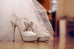 Wedding shoes and white dress Stock Photo