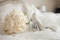 Wedding Shoes white rose bouquet. High heel luxury wedding shoes with white rose bouquet