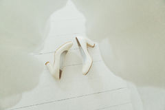 Wedding shoes on white wooden floor. In daylight Royalty Free Stock Images