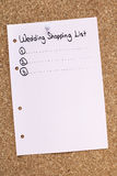 Wedding Shopping List. Pink wedding shopping list pinned on cork noticeboard Royalty Free Stock Images