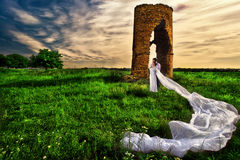 Wedding shot against abandoned ruins Stock Photo