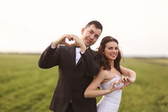 Wedding shot of bride and groom on field Stock Photos