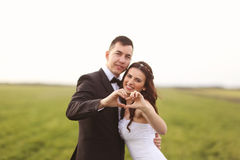 Wedding shot of bride and groom on field Stock Photo