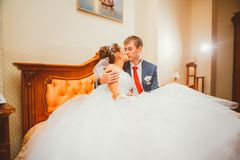 Wedding shot of bride and groom lying in a stylish bed Royalty Free Stock Photo