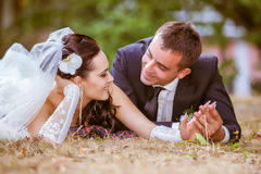 Wedding shot of bride and groom in park Stock Photos
