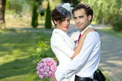 Wedding shot of bride and groom in park. Stock Photos