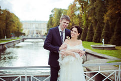 Wedding shot of bride and groom in park near river Stock Image