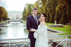 Wedding shot of bride and groom in park near river Royalty Free Stock Photography