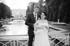 Wedding shot of bride and groom in park near river Royalty Free Stock Photo
