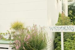 Wedding Sign Near House With Green Plants Royalty Free Stock Photos